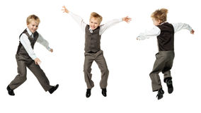 Little schoolboy plays in businessman Stock Photography