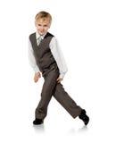 Little schoolboy plays in businessman Stock Photos