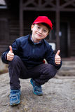 Little schoolboy thumbs up outdoor Stock Photography