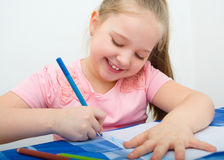 Portrait of girl drawing with colorful pencils. Closeupportrait of girl drawing with colorful pencils Stock Photography