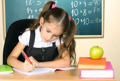 Little schoolchild in classroom Stock Image