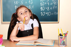 Little schoolchild in classroom Royalty Free Stock Images