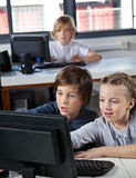 Little Schoolchildren Looking At Computer Monitor Royalty Free Stock Images