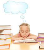 Little schoolgirl. Fall asleep after reading a book Royalty Free Stock Image