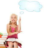 Little schoolgirl. Raised her hand to answer question Stock Photo