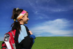 Little Schoolgirl. Little school girl with the schoolbag looking forward on holidays Royalty Free Stock Images
