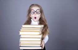 Little schoolgirl with books. Stock Images