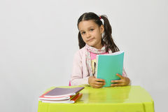 Little schoolgirl with books Stock Photo