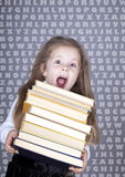 Little schoolgirl with books. Royalty Free Stock Photos