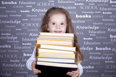 Little schoolgirl with books. Royalty Free Stock Photo