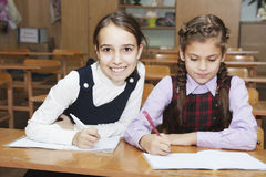 Little schoolgirl in the classroom Royalty Free Stock Images