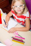 Little schoolgirl doing her lessons Stock Image