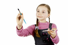 Little Schoolgirl draws Stock Images