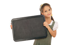 Little schoolgirl with empty chalkboard, horizonta Stock Images
