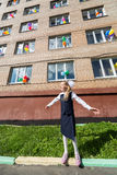 Little schoolgirl in front of the school. Decorated balloons stock image