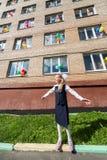 Little schoolgirl in front of the school Stock Image