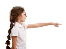 Little schoolgirl gesturing Stock Photo