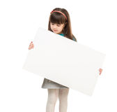 Little schoolgirl holding paper blank Royalty Free Stock Photography