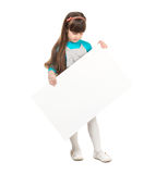 Little schoolgirl holding paper blank Royalty Free Stock Photo