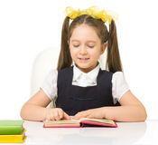 Little schoolgirl isolated Royalty Free Stock Photos