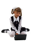 Little Schoolgirl With Laptop. Royalty Free Stock Photography