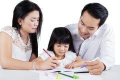 Little schoolgirl learn to write Stock Photos