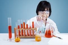 Little schoolgirl makes chemical tests Stock Photo