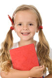 Little schoolgirl portrait with books and pencil Stock Photo