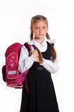 Little schoolgirl. Portrait of schoolgirl with pink satchel Stock Photography