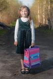 Little schoolgirl. Portrait of little schoolgirl with satchel Royalty Free Stock Image