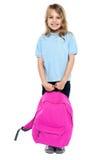 Little schoolgirl posing with pink backpack Stock Photo