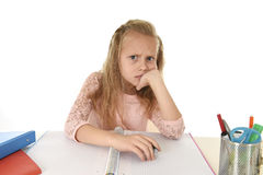 Little schoolgirl sad and tired looking depressed suffering stress overwhelmed by load of homework. Sweet little schoolgirl sad and tired looking depressed Stock Photography