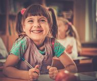 Little schoolgirl in school Stock Photo