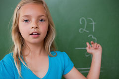 Little schoolgirl showing her result stock images