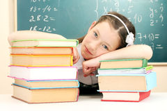 Little schoolgirl sleep in classroom Stock Photography