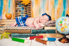 Little schoolgirl. A sleeping child on a pile of books. Royalty Free Stock Photography