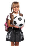 Little schoolgirl with soccer ball Stock Photo
