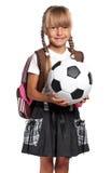 Little schoolgirl with soccer ball Stock Photo