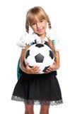 Little schoolgirl with soccer ball Stock Photos