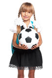 Little schoolgirl with soccer ball Royalty Free Stock Images