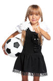 Little schoolgirl with soccer ball Stock Image