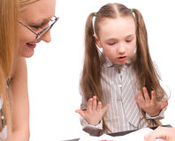 Little schoolgirl speak with teacher isolated Royalty Free Stock Image
