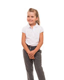 Little schoolgirl standing on white looking aside Stock Image
