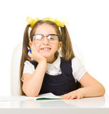 Little schoolgirl at the table Stock Photos