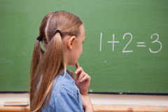 Little schoolgirl thinking Royalty Free Stock Images
