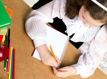 Little schoolgirl writing Stock Photos