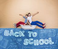 Little schoolkids on the sea Royalty Free Stock Photos