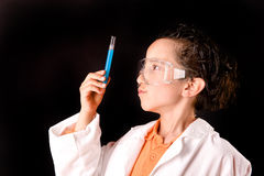 Little scientist. Boy with experiments isolated over dark background Stock Photography