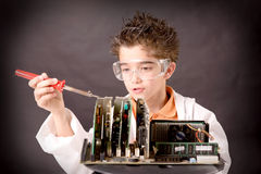 Little scientist. Boy with experiments isolated over dark background Stock Photo