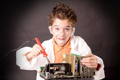 Little scientist. Boy with experiments isolated over dark background Royalty Free Stock Images